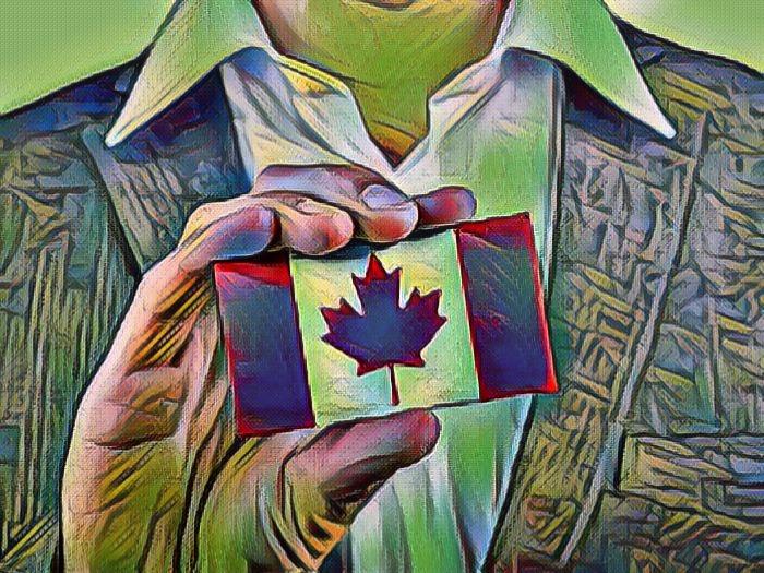 Канадский календарик в руке